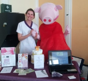 Michele from Pure Life Massage Therapy with Peppa Pig